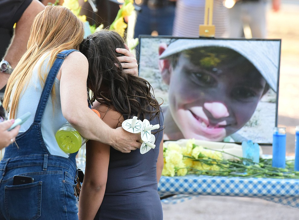 Some needed comforting during a candlelight vigil in honor of ten-year-old Christian Pearson at Memory Park in Chino Valley  Saturday, June 17. (Les Stukenberg/Courier)