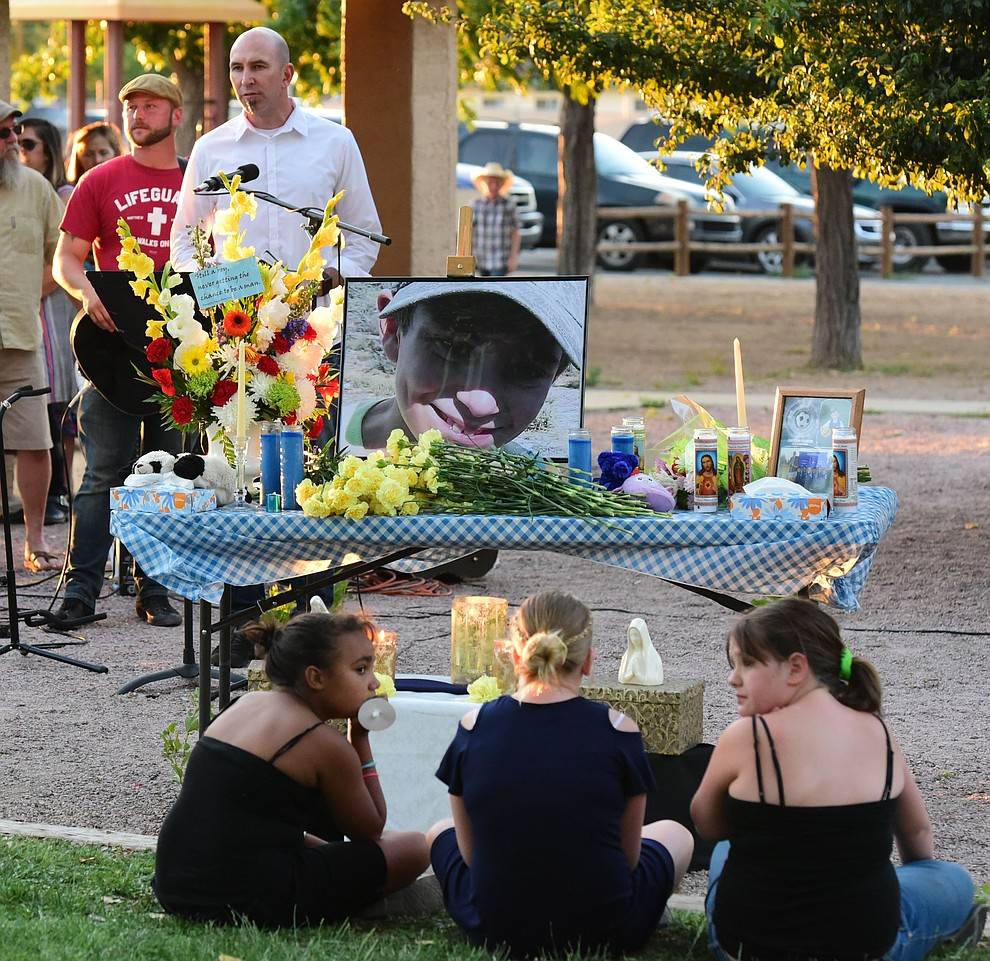Pastor Ron Merrell gave the opening prayer during a candlelight vigil in honor of ten-year-old Christian Pearson at Memory Park in Chino Valley  Saturday, June 17. (Les Stukenberg/Courier)
