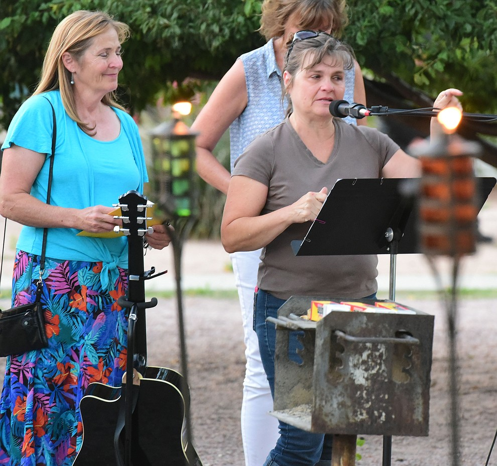 Kindergarten teacher Patty Hust talks about some of her memories of Christian during a candlelight vigil in honor of ten-year-old Christian Pearson at Memory Park in Chino Valley  Saturday, June 17. (Les Stukenberg/Courier)