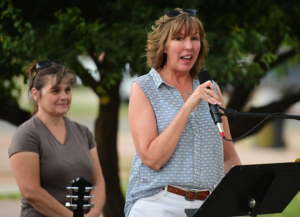 Third grade teacher Meredith Keyes talks about some of her memories of Christian during a candlelight vigil in honor of ten-year-old Christian Pearson at Memory Park in Chino Valley  Saturday, June 17. (Les Stukenberg/Courier)