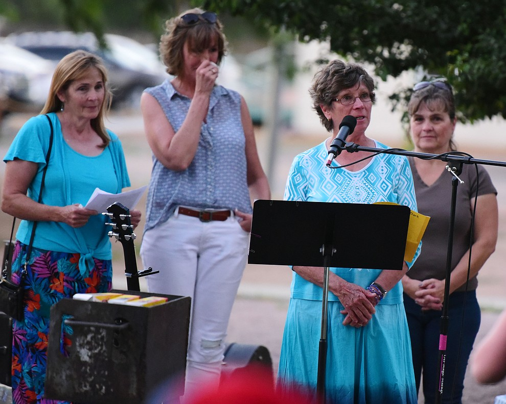 Fourth grade teacher Rosie Eldridge talks about some memories of Christian during a candlelight vigil in honor of ten-year-old Christian Pearson at Memory Park in Chino Valley  Saturday, June 17. (Les Stukenberg/Courier)