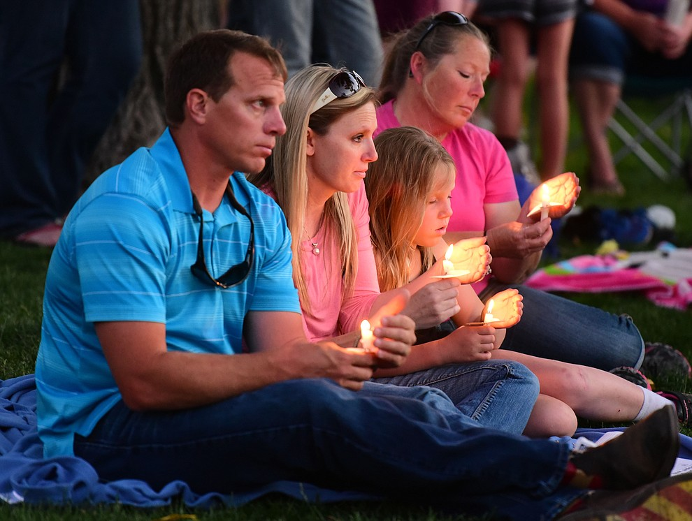 For some deep reflection was apparent during the candlelight vigil in honor of ten-year-old Christian Pearson at Memory Park in Chino Valley  Saturday, June 17. (Les Stukenberg/Courier)
