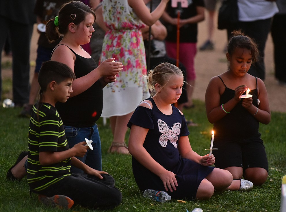 Close friends lit their candles and reflected during a candlelight vigil in honor of ten-year-old Christian Pearson at Memory Park in Chino Valley  Saturday, June 17. (Les Stukenberg/Courier)