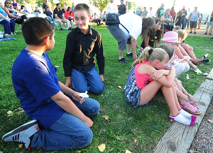 Best friends Dylan Gamboa-Wright (left) and Daniel Beasley were with other friends during a candlelight vigil in honor of ten-year-old Christian Pearson at Memory Park in Chino Valley  Saturday, June 17.
