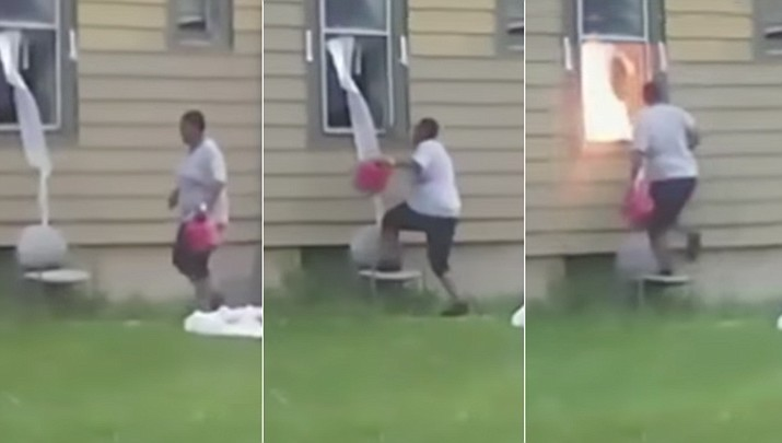 A woman has been caught on cellphone video pouring what appears to be gasoline through the window of a Milwaukee, Wisconsin home and setting it on fire. (AP video screenshots)