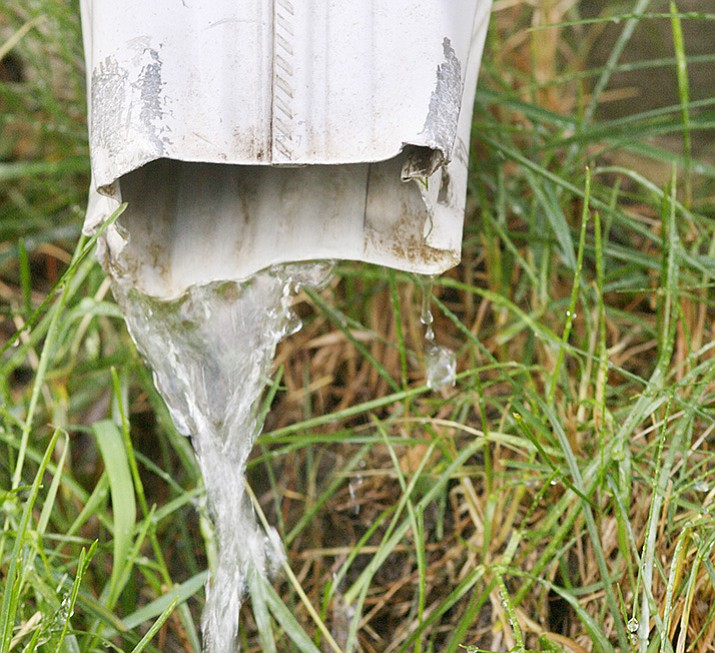 Check your rain gutters and down sprouts now to make sure they are clear before monsoon season begins. (Metro Creative)