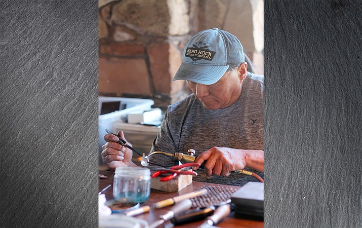 Hopi silversmith Duane Tawahongva gives a demonstration of Hopi silver overlay at Desert View Watchtower as part of Grand Canyon National Park's cultural demonstrator series.