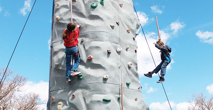 Visitors enjoy the new climbing wall at Rockin' the Wall on Route 66.
