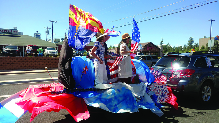A float in the parade proudly flies the American and Arizona state flags in last year's Fourth of July parade in Tusayan. Photo/Clarinda Vail