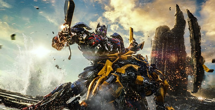 """This image released by Paramount Pictures shows Optimus Prime and Bumblebee, foreground, in a scene from, """"Transformers: The Last Knight."""""""