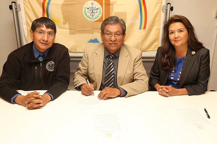 After carefully assessing the fire danger that exists on the Navajo Nation, President Begaye (center) and Vice President Nez (left), along with BIA Navajo Regional Director Sharon Pinto (right), signed into effect an executive order implementing Stage 1 fire restrictions.  Submitted photo