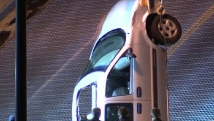 Rescue crews in Green Bay, Wisconsin had to pull a man and his car out of a gap in a drawbridge after the driver accidentally drove too far Thursday. (See video below)
