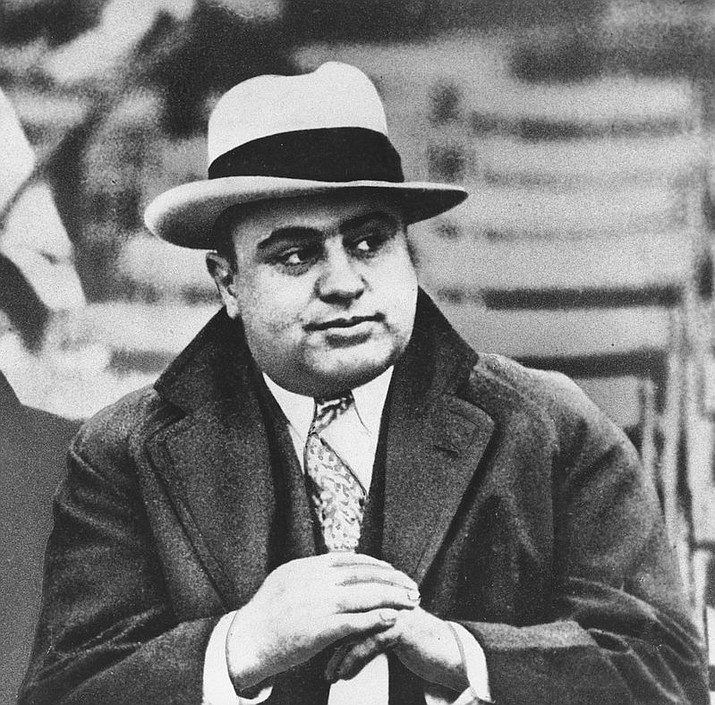 In this Jan. 19, 1931 photograph, Chicago mobster Al Capone is seen at a football game in Chicago. Artifacts connected to some of the nation's most notorious gangsters are being auctioned this weekend. (AP Photo/File)