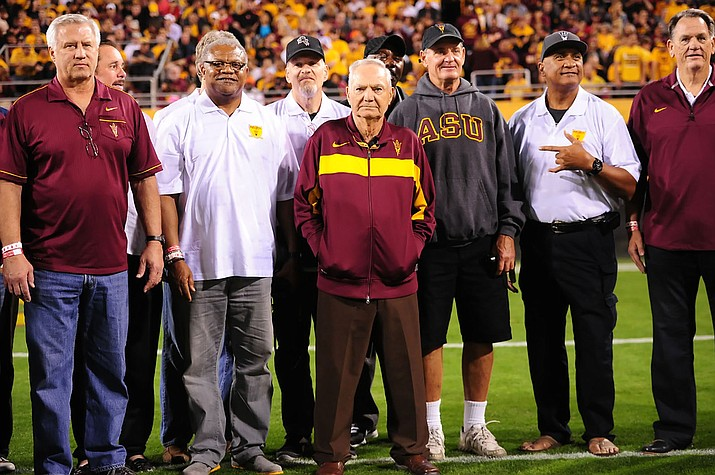 Frank Kush, maroon jacket, remained a part of the ASU football program, even after he was done coaching.