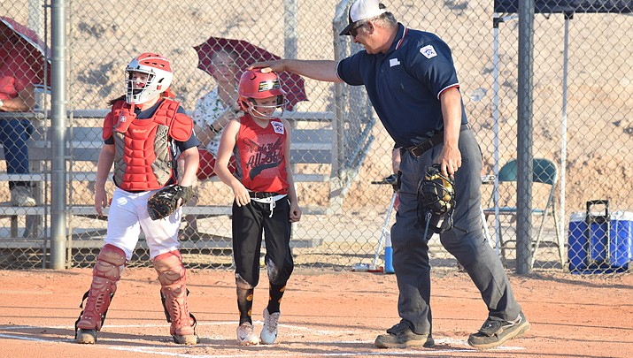 Little League softball minors open with tough loss
