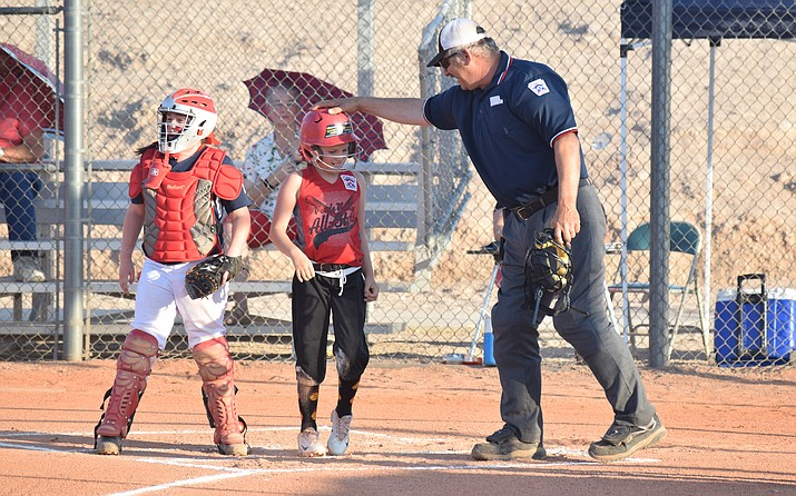 The home plate umpire congratulates Coco Gonough after she scored a run on Friday in Wickenburg during the first round of the district 10 tournament. The Verde Valley minors lost 26-12 to Prescott Valley.  (VVN/James Kelley)
