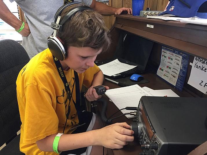 Jackson Fuller, an amateur radio technician, operates a radio during Yavapai Amateur Radio Club's annual Amateur Radio Field Day. (Max Efrein/Courier)
