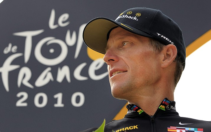 In this July 25, 2010, file photo, Lance Armstrong of the United States looks back on the podium after the 20th and last stage of the Tour de France cycling race in Paris. (Bas Czerwinski/AP, File)