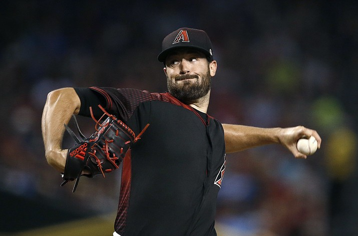 Arizona Diamondbacks' Robbie Ray throws a pitch to the Philadelphia Phillies during the first inning of a baseball game Saturday, June 24, 2017, in Phoenix. (AP Photo/Ross D. Franklin)