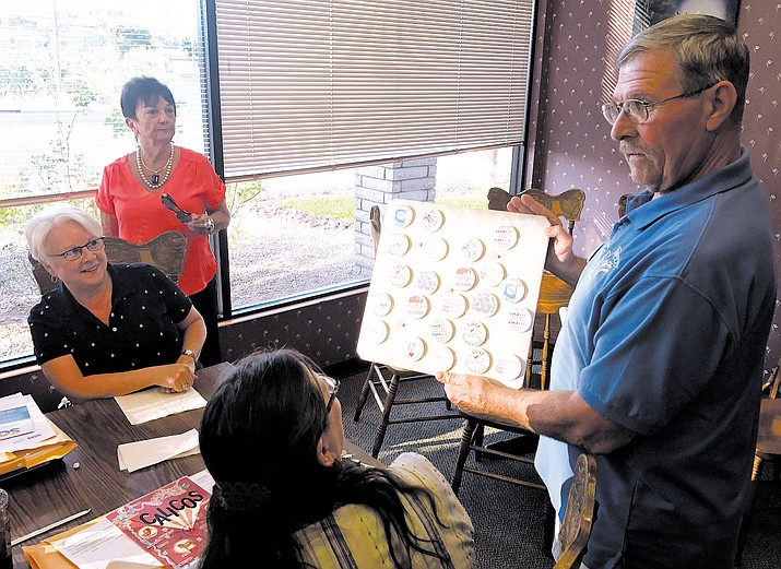 Mohave County Democrats Central Committee Treasurer Danny Baker (right) shows off buttons that support the Democratic Party.