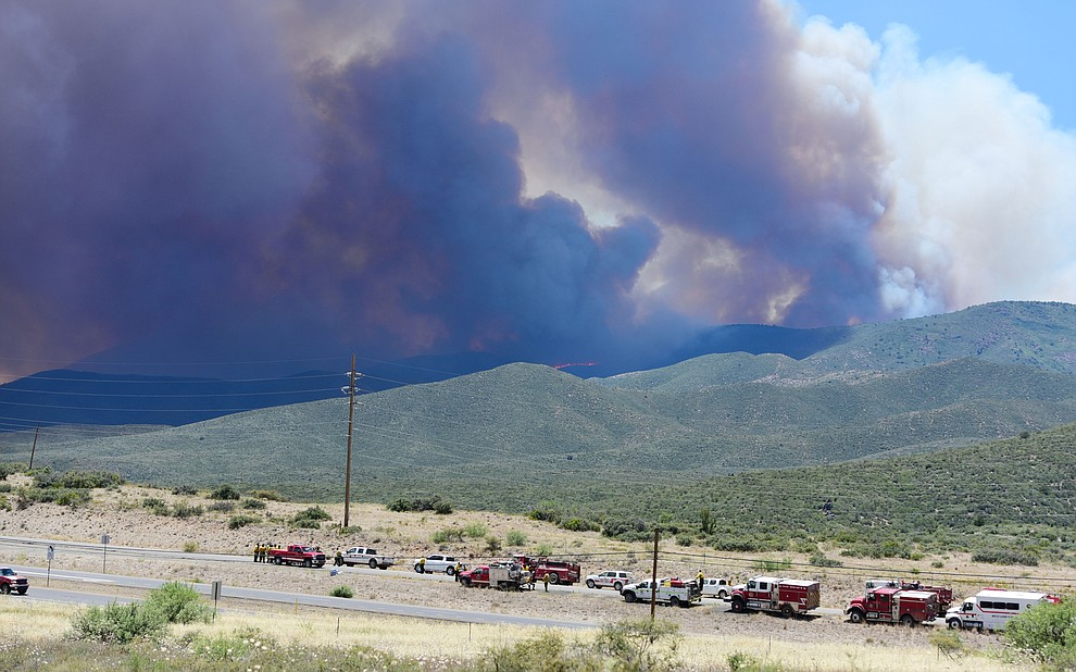 Fire crews both ground and aerial do their best on the Goodwin Fire as it approaches the town of Mayer Tuesday, June 27. (Les Stukenberg/Courier)