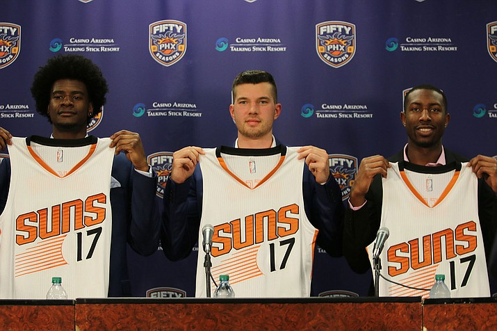 From left, Josh Jackson, Alec Peters and Davon Reed hold up Suns jerseys with the number 17, indicating they are part of the 2017 Phoenix Suns draft class.