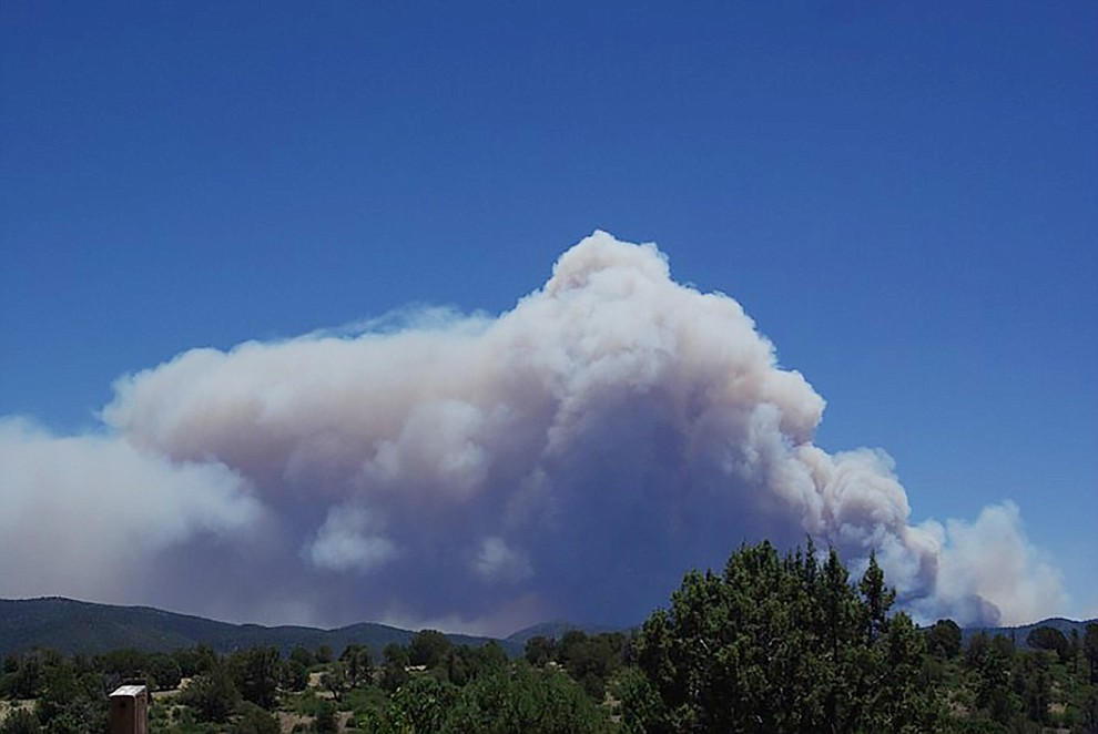 Smoke rises from the Goodwin Fire on Tuesday afternoon as seen from a home's back yard on East Murphy Way in the Ranch. (Wesley Redus/Courtesy)
