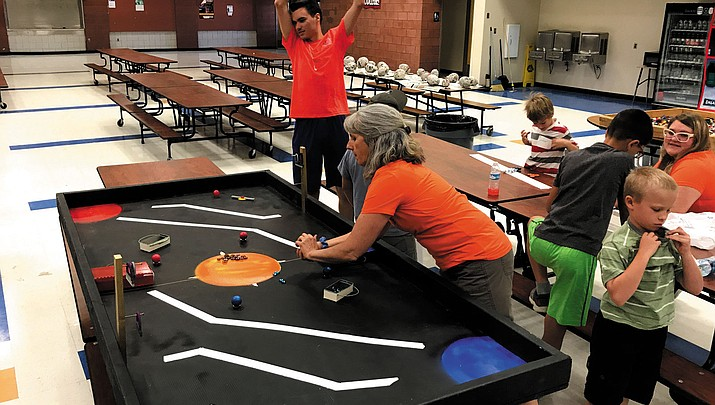 Children explore robotics  during week-long summer camp