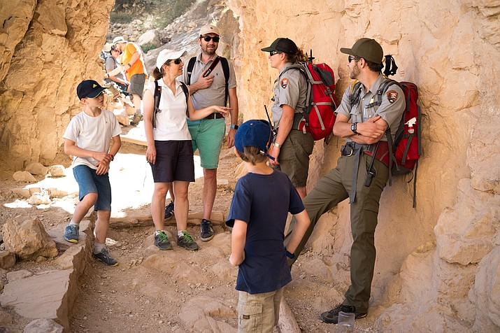 Preventative Search and Rescue rangers talk to tourists on the Bright Angel Trail.