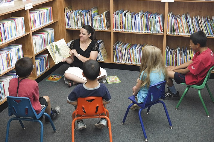 Angela Hamby reads to children at the Williams Library Summer Reading program.