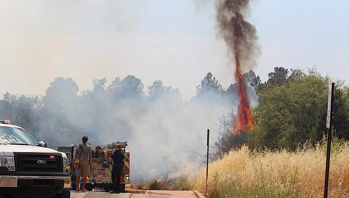 Charcoal briquettes spark brush fire in Sedona