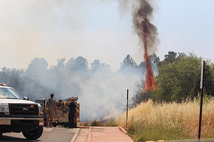 Sedona firefighters were dispatched to Posse Ground Park for a wildland fire, about ¼ acre in size, Saturday. fire officials said the fire was caused when charcoal briquettes were dumped on the ground following a barbecue. (Photo courtesy of Wing)