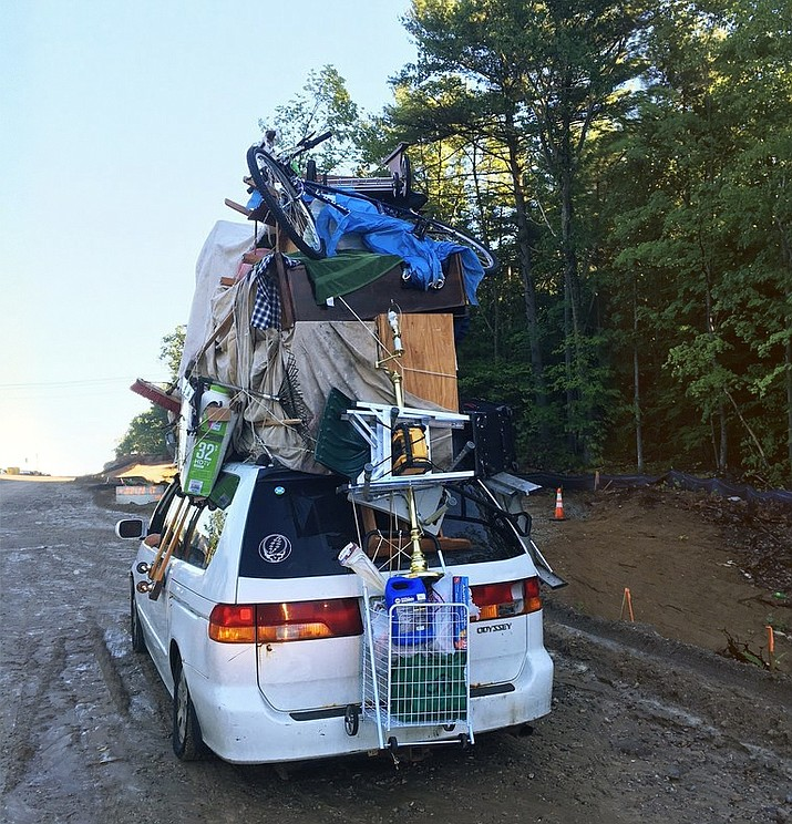 A vehicle stacked with household goods on its roof, including furniture, boxes and a wheeled basket, was pulled over Wednesday by New Hampshire State Police on Interstate 93 near Londonderry, N.H. (Nicholas Iannone/New Hampshire State Police via AP)