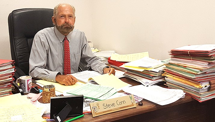 Judge Steven Conn, who has served Mohave County for 40 years, does everything by hand rather than using a computer.