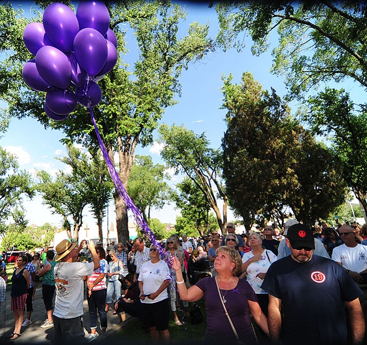 Theresa Miller releases 19 purple balloons and one white balloon as the City of Prescott and Yavapai County hold a Remembrance for the Granite Mountain Hotshots on the courthouse plaza Friday, June 30.