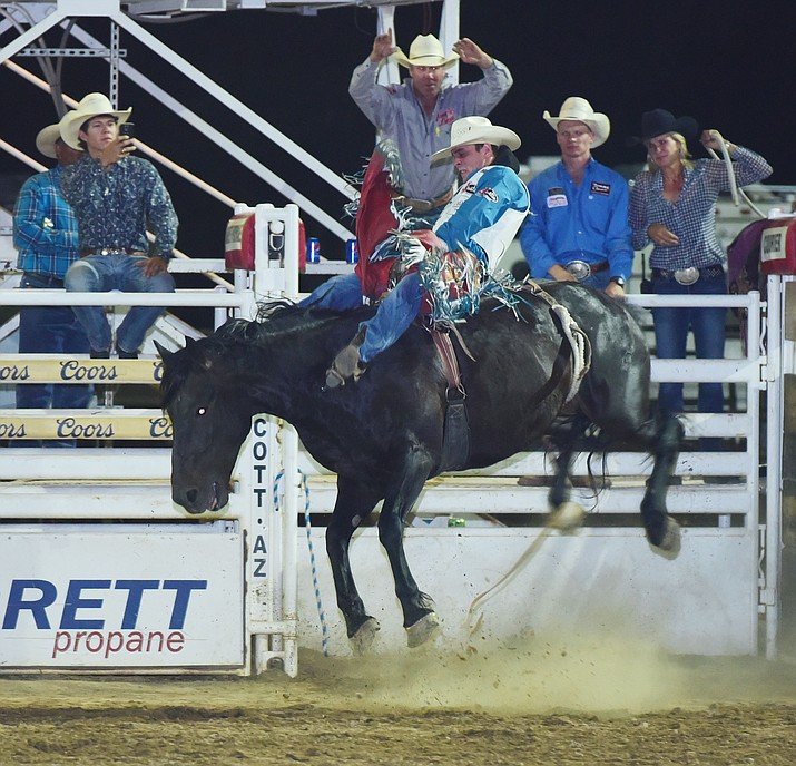 Tim O'Connell, currently the world's No. 1-ranked bareback rider and defending Prescott Frontier Days champ, rides for a score of 85 during the third performance of the Prescott Frontier Days Rodeo on Friday, June 30. (Les Stukenberg/Courier)