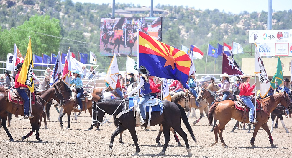 The grand entry during the 4th performance of the 2017 Prescott Frontier Days Rodeo at the Prescott Rodeo Grounds Saturday, July 1.  (Les Stukenberg/Courier)