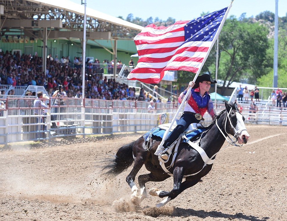 Sami Kilduff runs the American Flag during the 4th performance of the 2017 Prescott Frontier Days Rodeo at the Prescott Rodeo Grounds Saturday, July 1.  (Les Stukenberg/Courier)