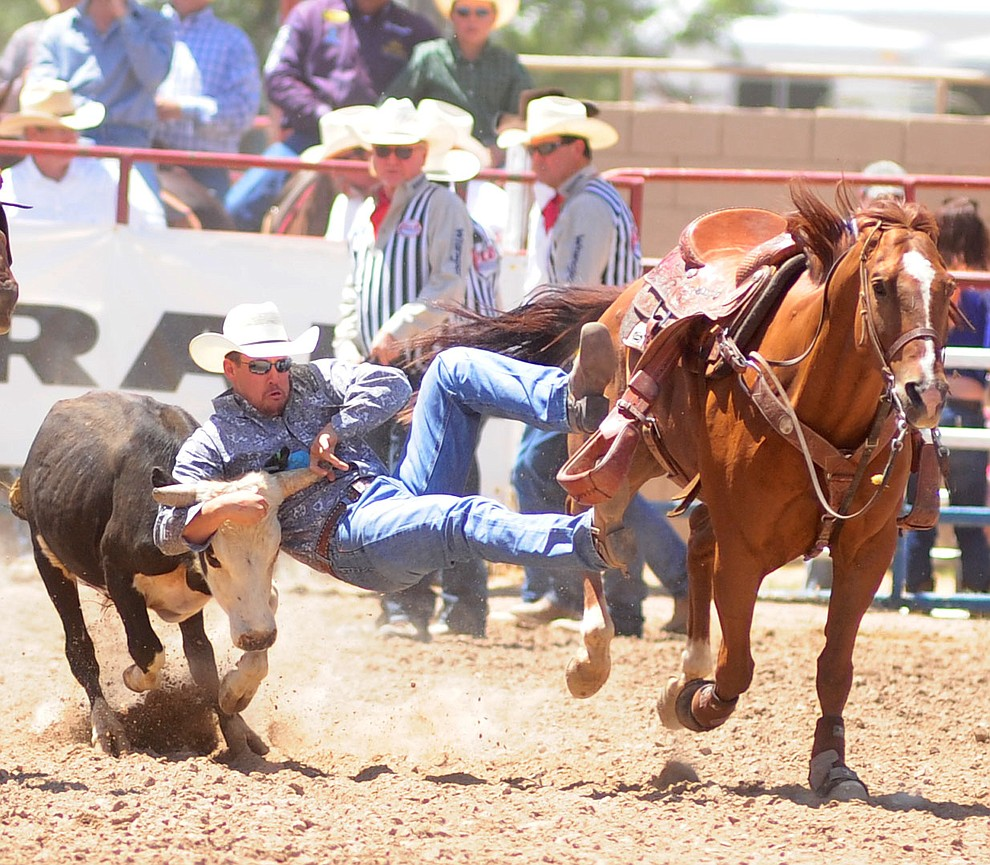 Wyatt Lyndsay has a 4.6 second run in the steer wrestling during the 4th performance of the 2017 Prescott Frontier Days Rodeo at the Prescott Rodeo Grounds Saturday, July 1.  (Les Stukenberg/Courier)