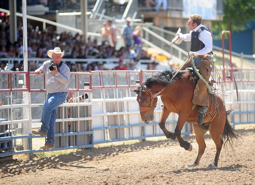 Nick Kimble poses for the crowd in the Cowpuncher's Ranch Bronc Riding during the 4th performance of the 2017 Prescott Frontier Days Rodeo at the Prescott Rodeo Grounds Saturday, July 1.  (Les Stukenberg/Courier)