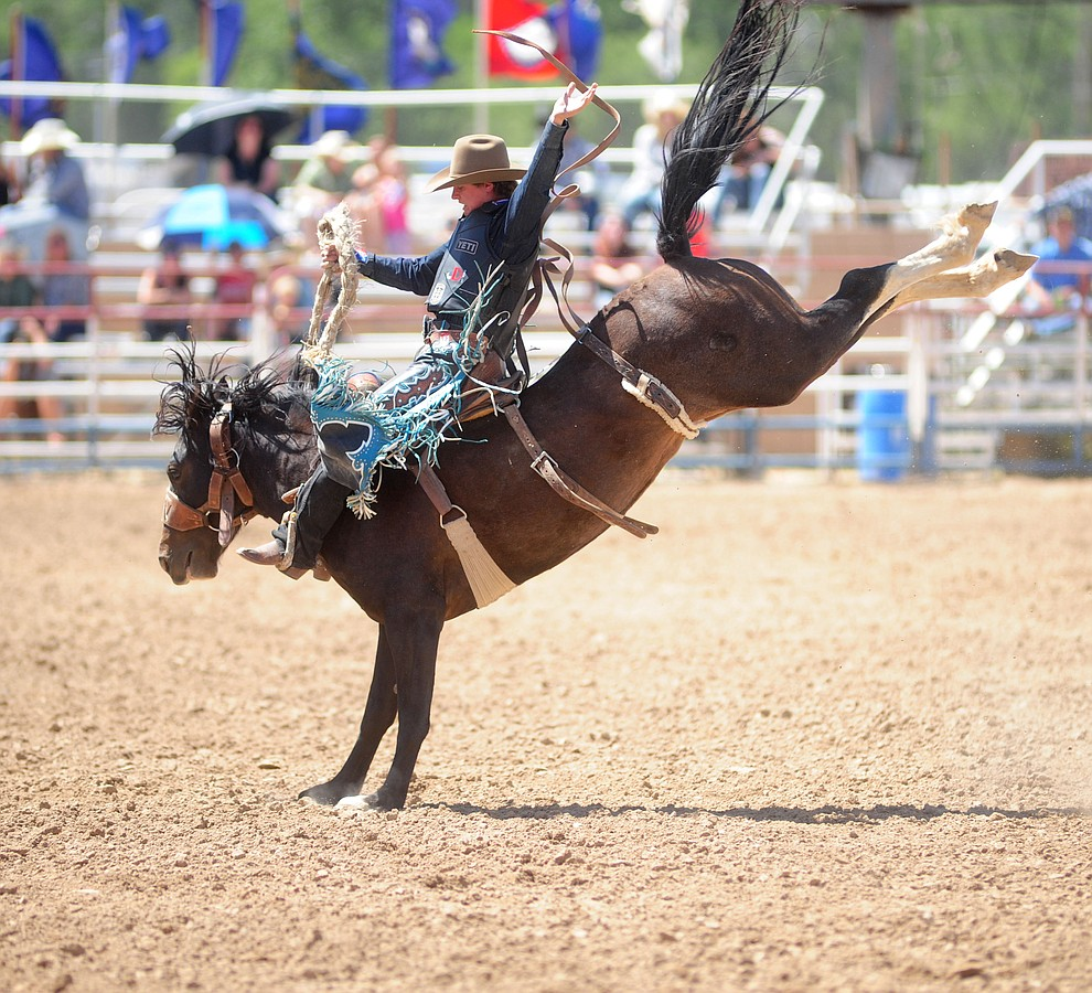Ryder Wright score an 80 on Brown Sugar in the Saddle Bronc during the 4th performance of the 2017 Prescott Frontier Days Rodeo at the Prescott Rodeo Grounds Saturday, July 1.  (Les Stukenberg/Courier)