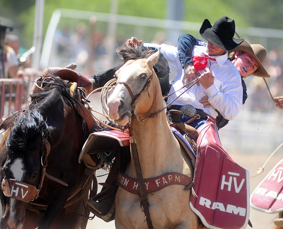 Ryder Wright gets off after scoring an 80 on Brown Sugar in the Saddle Bronc during the 4th performance of the 2017 Prescott Frontier Days Rodeo at the Prescott Rodeo Grounds Saturday, July 1.  (Les Stukenberg/Courier)
