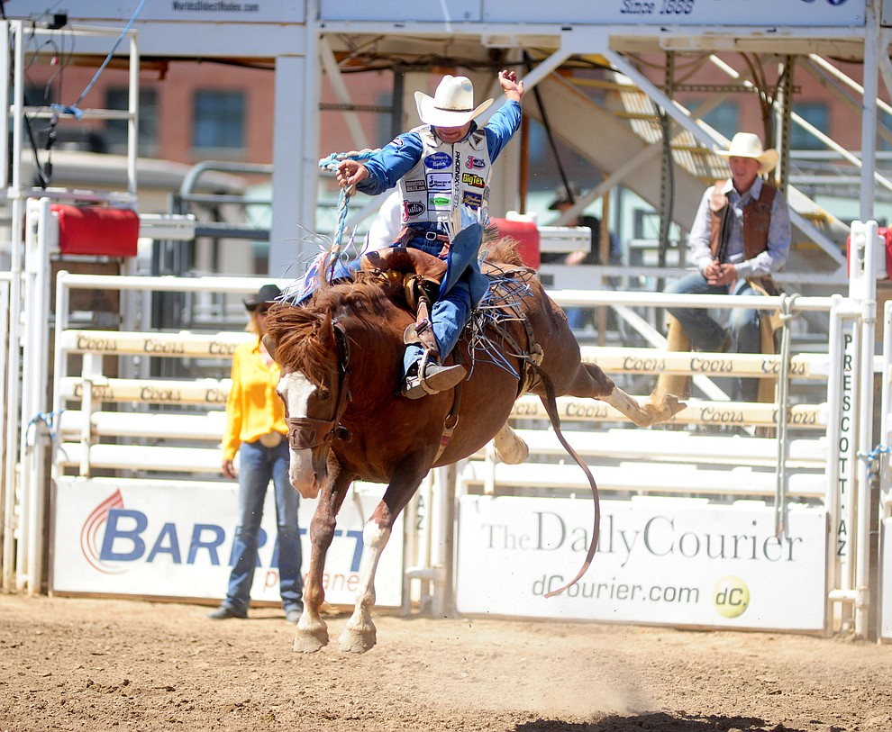 Heith DeMoss scores 78.5 on Sombrero in the Saddle Bronc during the 4th performance of the 2017 Prescott Frontier Days Rodeo at the Prescott Rodeo Grounds Saturday, July 1.  (Les Stukenberg/Courier)