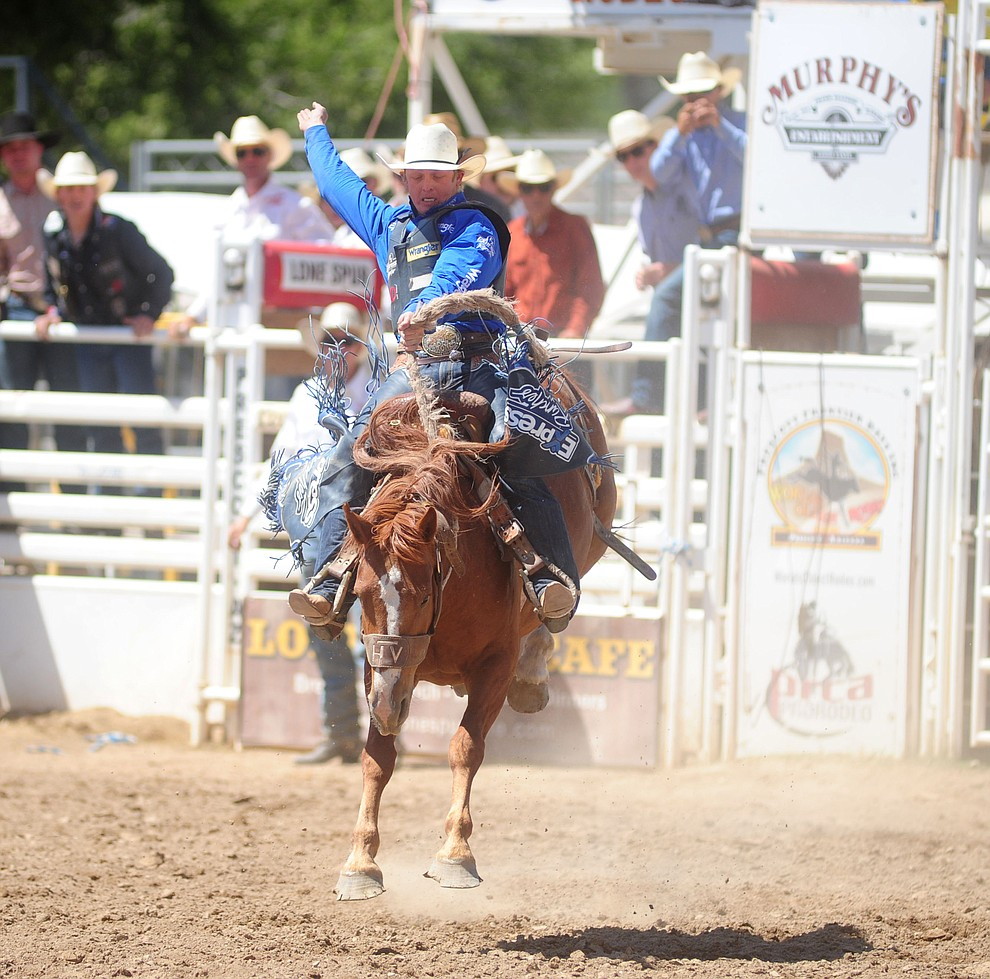 Spencer Wright scores 64 on Ring Binder in the Saddle Bronc during the 4th performance of the 2017 Prescott Frontier Days Rodeo at the Prescott Rodeo Grounds Saturday, July 1.  (Les Stukenberg/Courier)