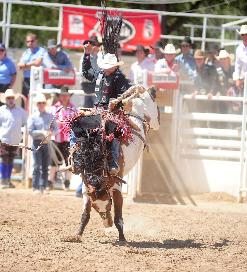Cody Wright on Painted Bear in the Saddle Bronc during the 4th performance of the 2017 Prescott Frontier Days Rodeo at the Prescott Rodeo Grounds Saturday, July 1.  (Les Stukenberg/Courier)
