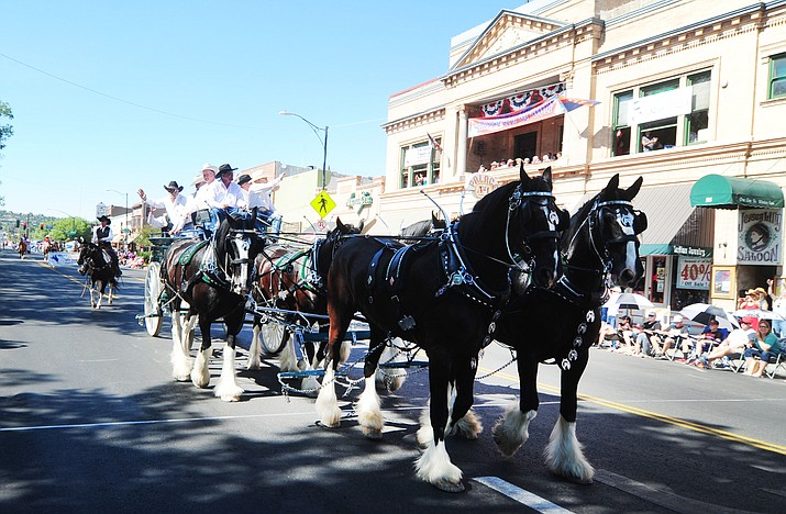 The Diamond Z English Shire Horses brought the rodeo committee to the Prescott Frontier Days Rodeo Parade through downtown Prescott Saturday, July 1.  (Les Stukenberg/Courier)