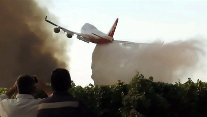 A Global Supertanker, based in Marana, Arizona, makes a drop over a fire in Argentina. The 747-400 is not certified to do the same in the U.S.