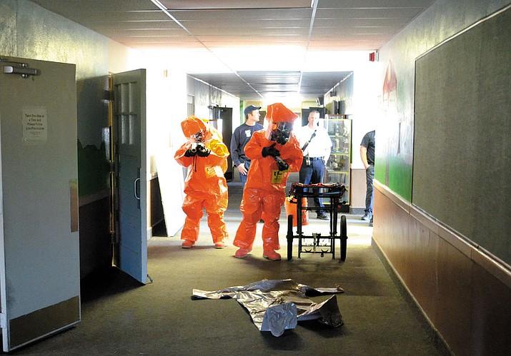 91st CST sergeants Grace Ogesen and Daniel Coe begin a search for hazardous chemicals inside Palo Christi School.