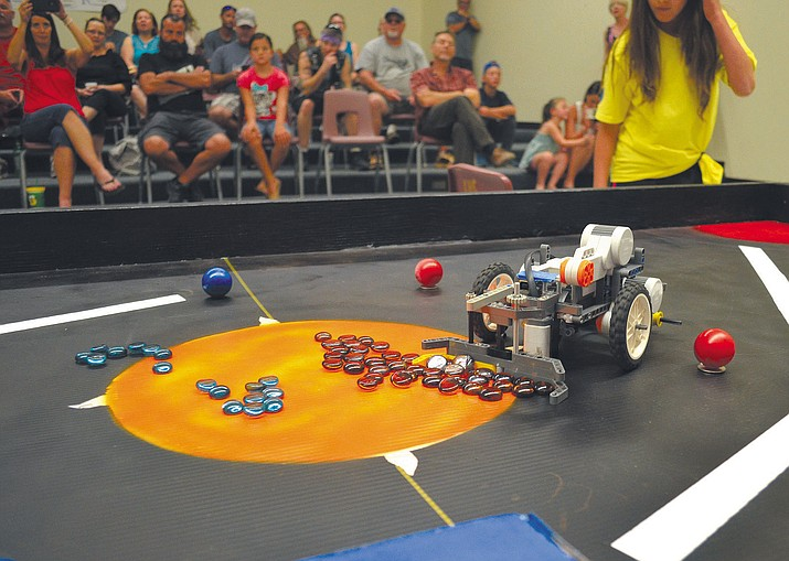 "A Lego robot moves stones across a table. Two robots faced off while moving and lifting different objects across the ""space-table"" for points. The robots also had avoid small obstacles in order to not lose points."