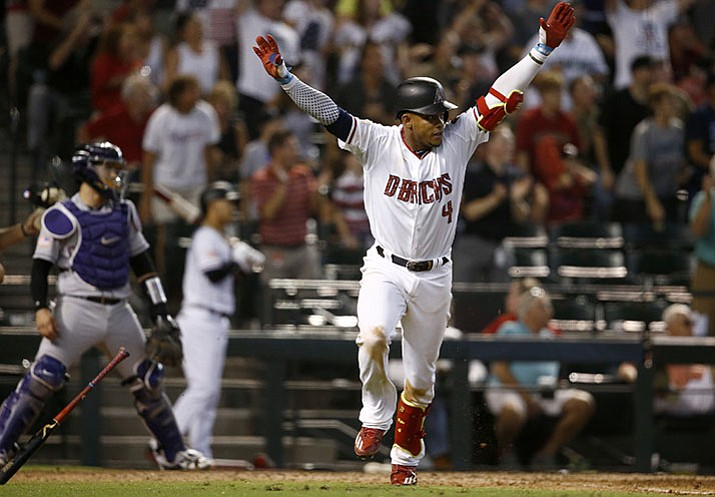 Diamondbacks' Ketel Marte celebrates his walk off single against the Colorado Rockies as Rockies catcher Tony Wolters, left, looks on during the ninth inning Sunday, July 2, in Phoenix. The Diamondbacks defeated the Rockies 4-3.